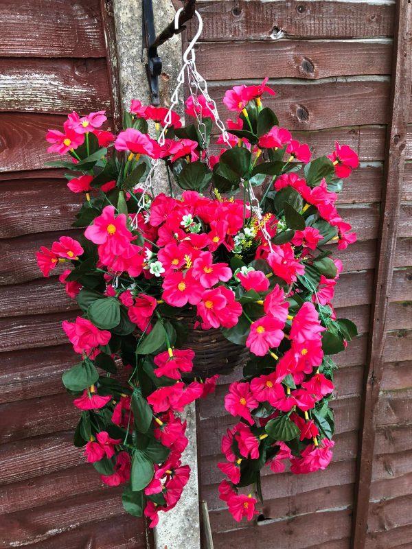 pink artificial flowers hanging basket