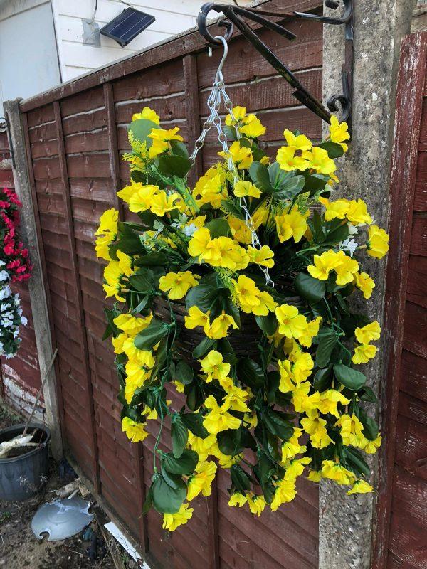 yellow artificial flower hanging basket