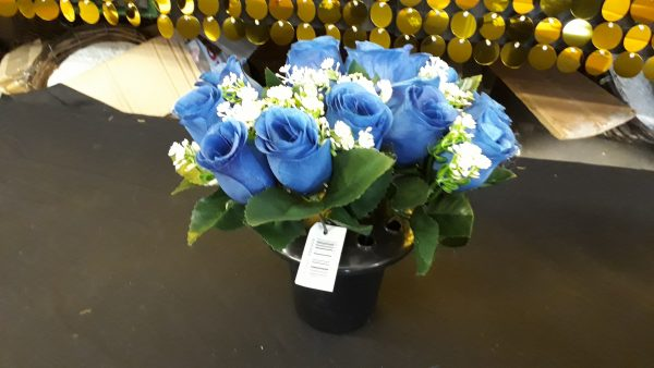 A Black Plastic Grave Pot with Royal Blue Rosebuds and Gyp